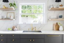08 a graphite grey kitchen with a white marble wall and countertops plus touches of gold for more chic