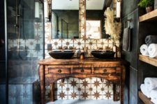 08 a refined bathroom with a white star tile accent wall and dark matte tiles plus a refined vintage wooden vanity