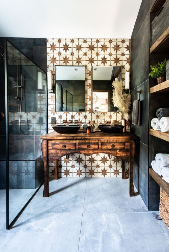 a refined bathroom with a white star tile accent wall and dark matte tiles plus a refined vintage wooden vanity