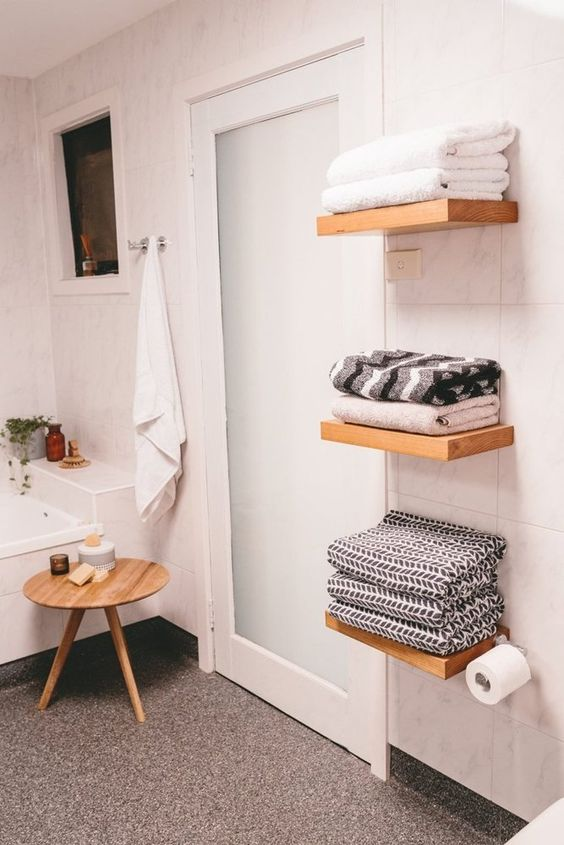 floating shelves for towels don't look bulky and don't clutter your bathroom, this is a cool solution