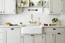 08 retro black fixtures and matching sconces give the kitchen a strong retro feel