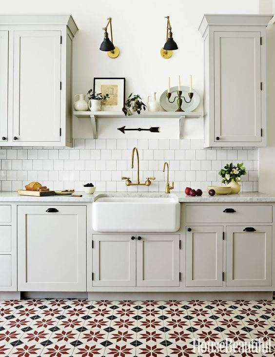 retro black fixtures and matching sconces give the kitchen a strong retro feel