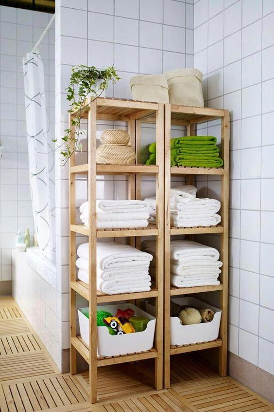 Molger shelves by IKEA used for storing towels, baskets with soaps and foams, kids' toys and other stuff