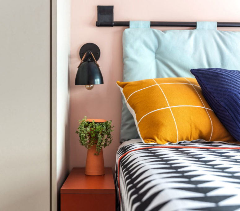 Bright bedding continues the decor style