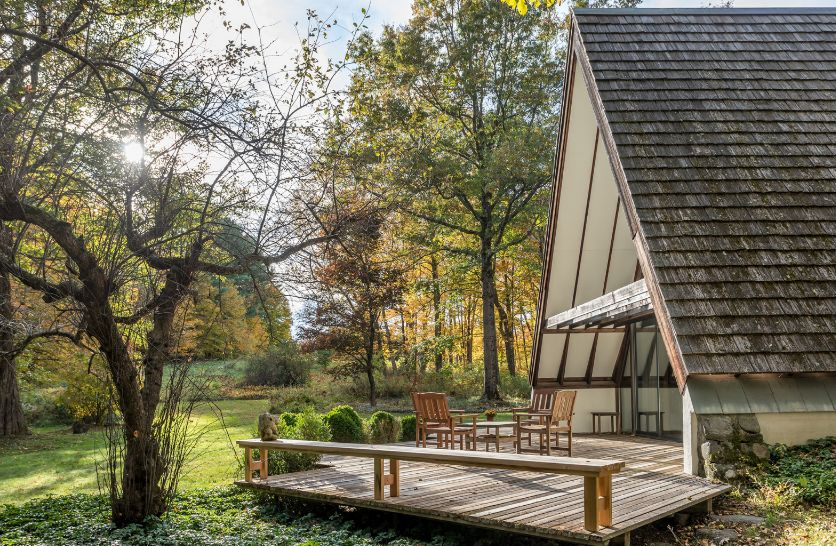 The house also has multiple wooden decks which extend the living spaces outdoors