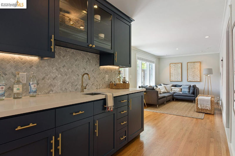The lower area has a bar and a cozy living space with a graphite grey corner sofa