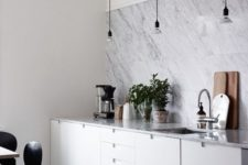 10 a modern white kitchen with a white marble tile backsplasj and countertops looks chic, elegant and stylish