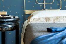 10 navy and gold star wallpaper and a gold bed with gold and navy bedding will make up a beautiful celestial bedroom