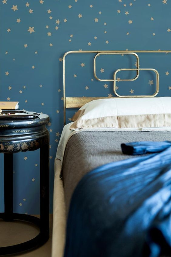 navy and gold star wallpaper and a gold bed with gold and navy bedding will make up a beautiful celestial bedroom