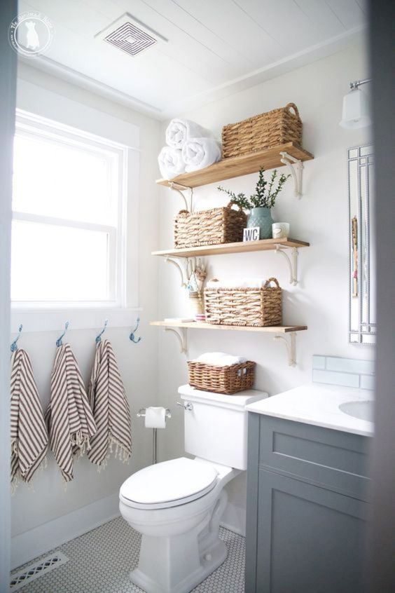 open shelves with baskets can store towels comfortably and here they take just some awkward space over the toilet