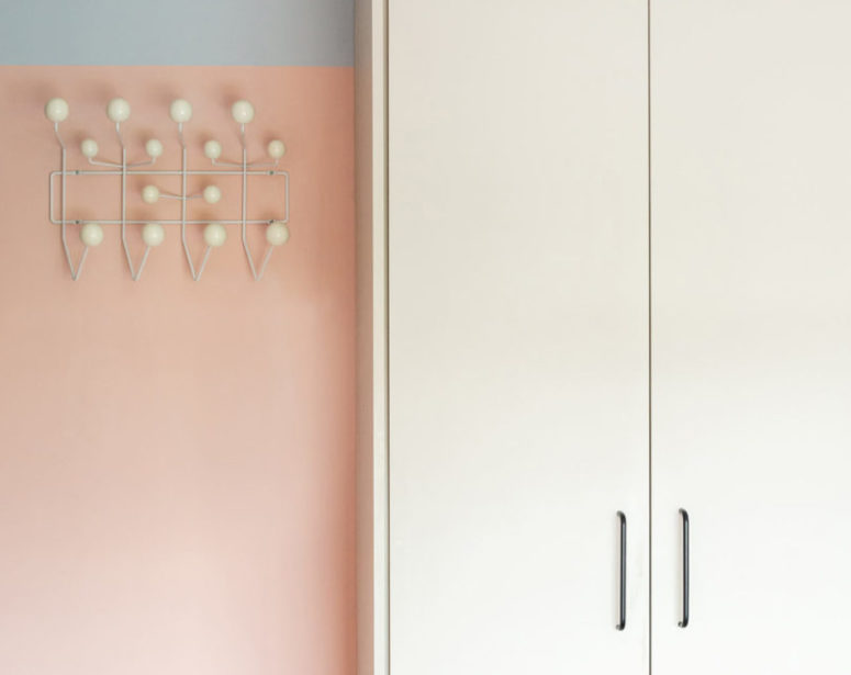 The storage unit is neutral, it stands out on a color block pastel wall