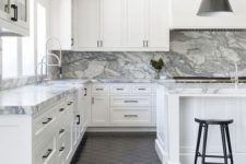 11 a neutral farmhouse kitchen with a white marble backsplash and countertops and black touches and a black floor