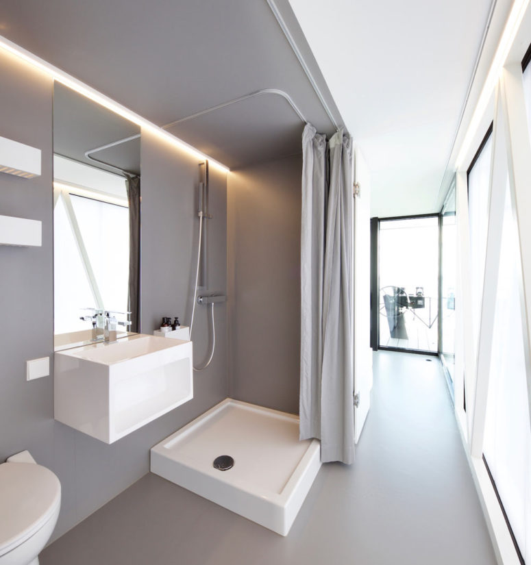 a small yet practical bathroom with a shower