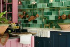 12 a bright kitchen with navy and pink cabinets and a bright pink kitchen island plus a wooden stool