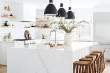 12 a white kitchen with sleek cabinets, floating shelves, a white marble kitchen island and black pendant lamps