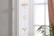 13 a beautiful gold star wall hanging or window hanging will bring a slight celestial touch to your space