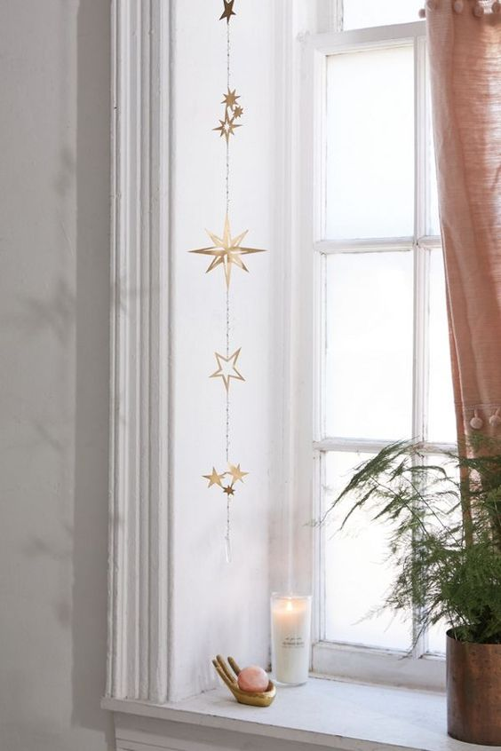 a beautiful gold star wall hanging or window hanging will bring a slight celestial touch to your space