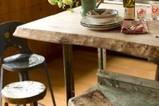 13 a rough wooden table and kitchen island, with mix and match wooden stools looks very rustic