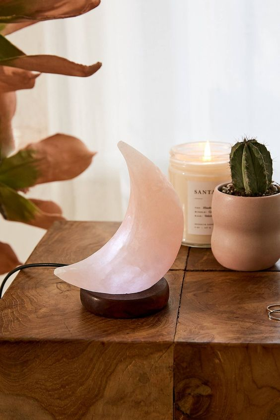 a beautiful pink Himalayan salt table lamp is a chic and romantic decoration for a modern space
