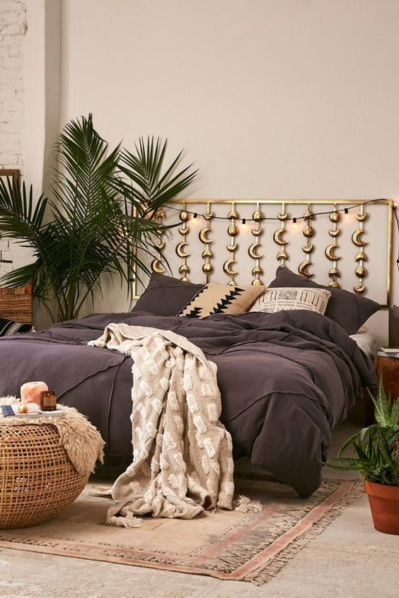 a boho bedroom with phases of the moon headboard in gold is a perfect choice for a celestial space