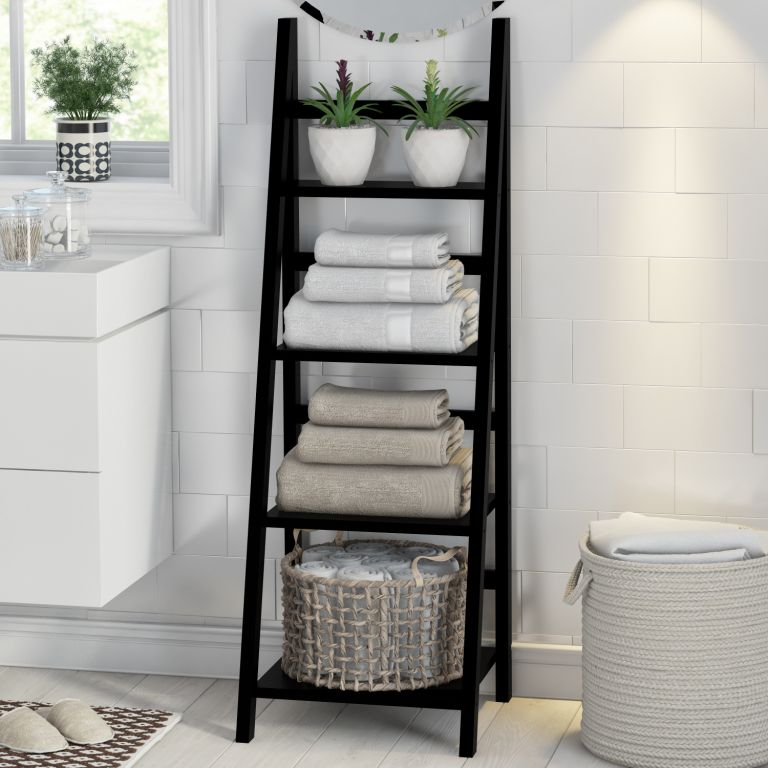 a black ladder is a space-saving storage unit for any bathroom, it works not only for towels but also for other pieces