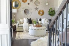16 a catchy and bright gallery wall with mirrors in gold and silver frames and various stars here and there