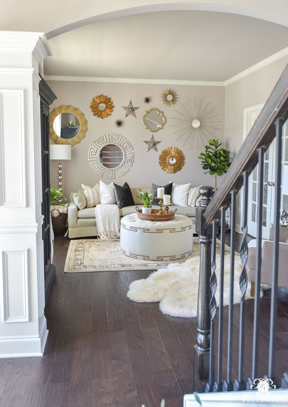 a catchy and bright gallery wall with mirrors in gold and silver frames and various stars here and there