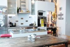 16 a quirky kitchen with a wooden table and al mismatching chairs and stools at the tables