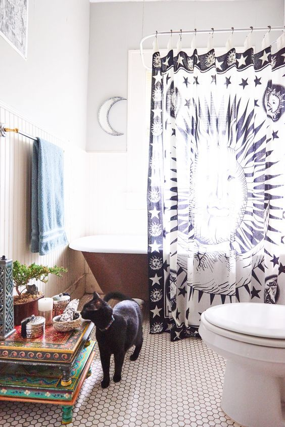 a celestial navy and white printed curtain for a cool celestial touch in the bathroom