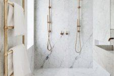 an elegant white marble shower area design
