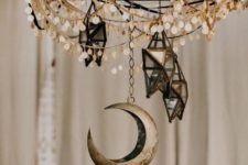 18 a chandelier with coins, 3D star candleholders and a moon will make your space very boho and celestial