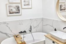 18 a small contemporary bathroom with a white marble backsplash and white furniture plus a gallery wall
