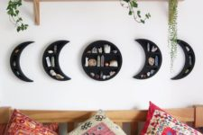 19 a cool phases of moon wall shelf in black with geodes is a very lovely home decor idea