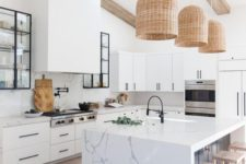 19 statement wicker pendant lamps over the kitchen island give a cozy and welcoming feel to the space