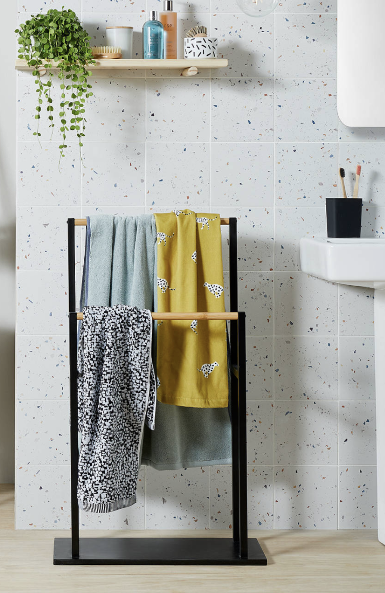 a free-standing towel rail is a nice towel storage solution for a bathroom that isn't tight on space