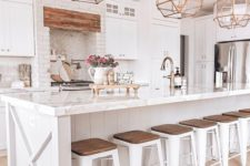 20 a white farmhouse kitchen with vintage gold faceted pendant lamps over the kitchen island