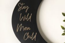 21 a stylish black matte moon sign with gold calligraphy is a lovely modern celestial decoration that can be attached anywhere