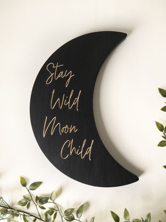 a stylish black matte moon sign with gold calligraphy is a lovely modern celestial decoration that can be attached anywhere