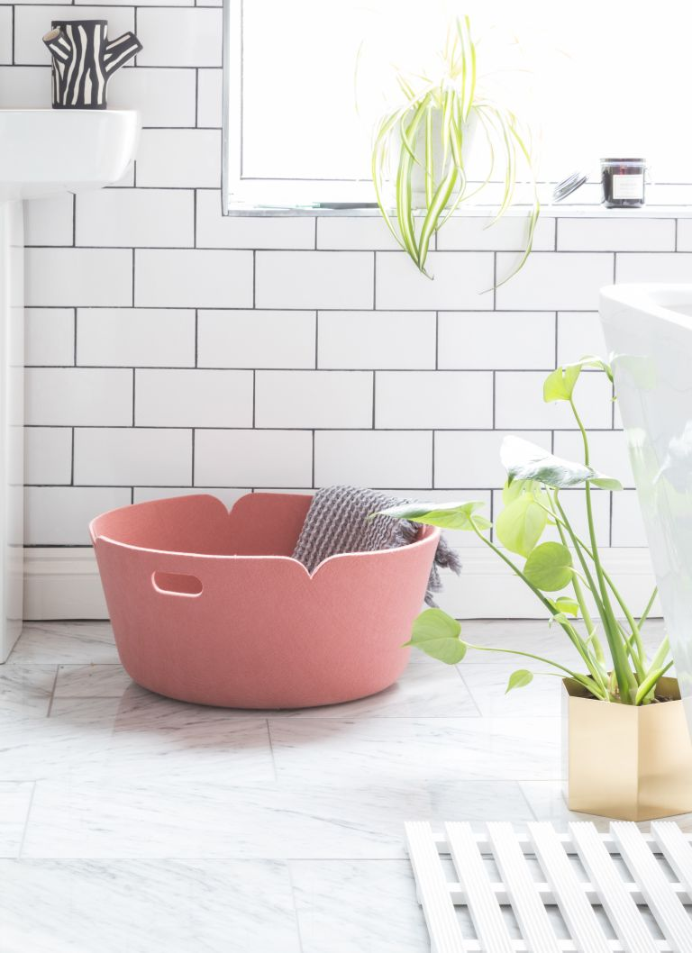 a pink felt laundry basket like this one can store a lot of towels and it looks pretty and cool