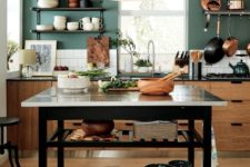 23 a functional kitchen island with two open shelves under the tabletop is a stylish and practical idea