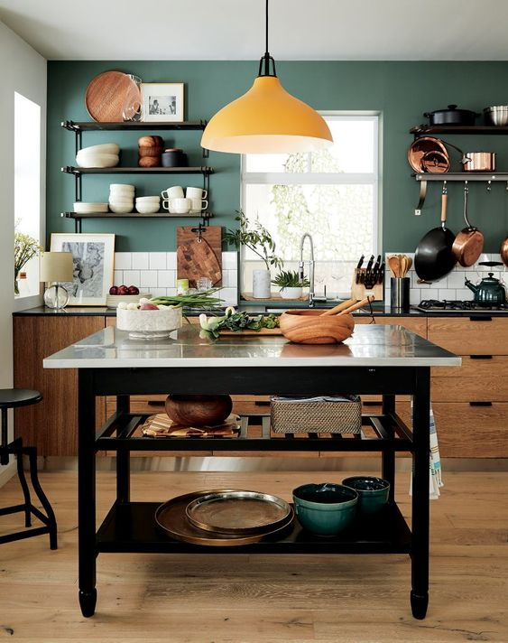 a functional kitchen island with two open shelves under the tabletop is a stylish and practical idea