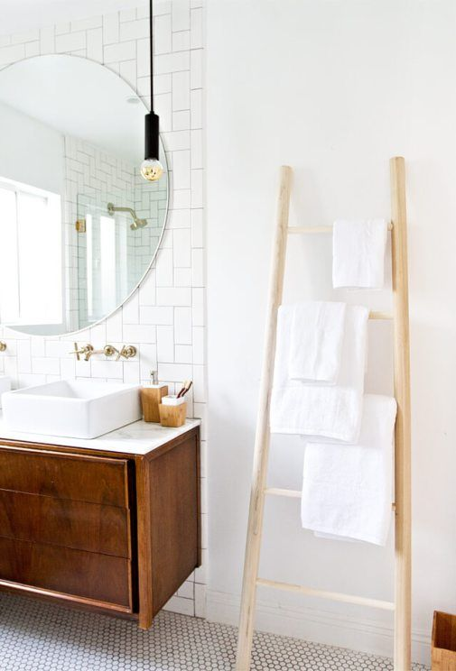 a simple wooden ladder with some towels is a cool space-saving towel storage idea for every kind of bathroom