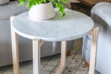 24 a stylish side table or plant stand with wooden legs and a white marble tabletop is a stylish idea