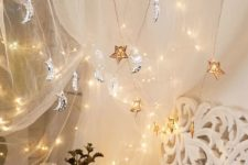24 gold star and silver moon lights over the bed will make your dreams celestial and romantic