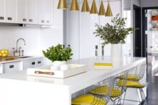 25 a cool and sleek kitchen island that doubles as a dining table, bright stools for sitting
