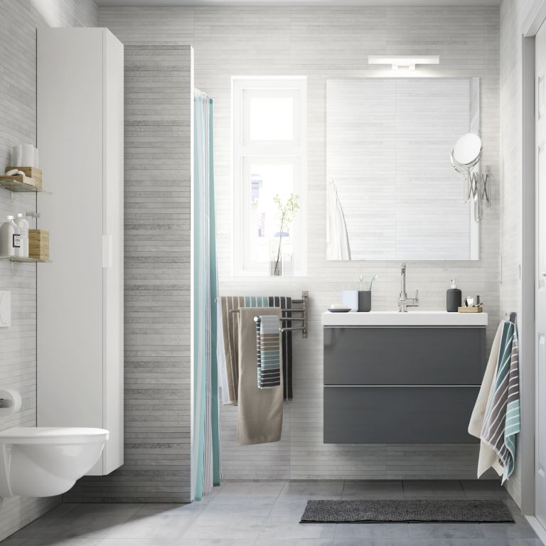 a wall-mounted multi-rail towel storage piece is a smart and cool towel storage unit for any bathroom
