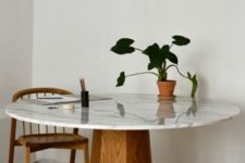 25 an elegant mid-century dining table with a wooden faceted base and a white marble tabletop