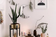 25 mini moon mirrors and abstract artworks plus herbs look cool and bring a romantic celestial feel to the space
