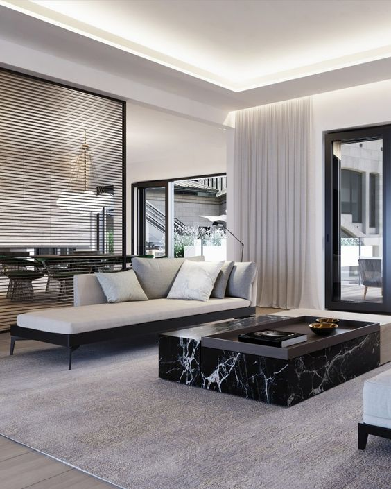 an elegant contemporary living room accented with a black marble slab table that brings ultimate luxury