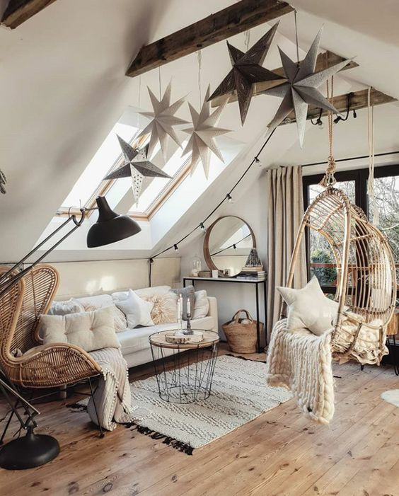 oversized hanging stars attached to the wooden beam and some star pillows bring a celestial feel to the space